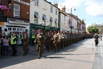 Soldiers marching through town